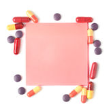 Colorful pills and paper for notes Stock Photo