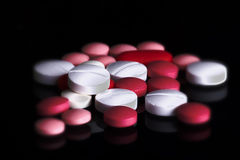 Colorful pills on pile Stock Photo