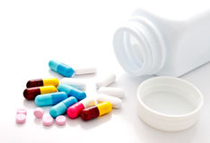 Colorful pills and plastic bottle Royalty Free Stock Photo