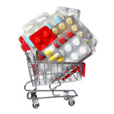 Colorful pills in shopping cart isolated on white. concept Royalty Free Stock Photography