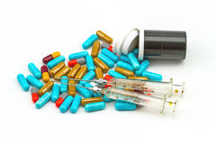 Colorful pills , syringe and black bottle tablets Stock Images