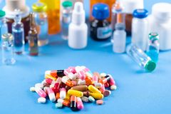 Colorful pills and tablets on background stock images