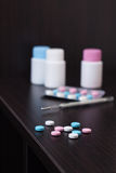 Colorful pills and thermometer Stock Photo