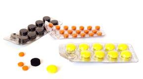 Colorful pills on white Stock Photos
