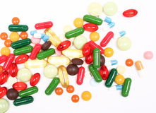 Colorful pills on white background Stock Photos