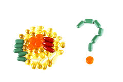 Colorful pills on white with a question mark Royalty Free Stock Photography