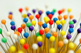 Colorful pin heads Royalty Free Stock Images
