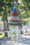 Colorful pinata. Multi colored cone shaped pinata Royalty Free Stock Photography