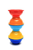 Colorful Pinch Bowls. Orange, red, blue, and yellow colored pinch bowls on white background Royalty Free Stock Images