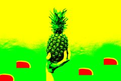 Colorful pineapple is holding a hand. Modern concept, pop art. Green and yellow colors. Summer mood, party concept. Colorful pineapple is holding a hand. Modern royalty free stock photo