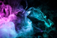 Background from the smoke of vape. Colorful pink  and blue a smoke  on a black isolated background. Background from the smoke of vape Stock Photos