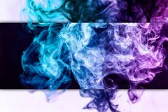 Frozen abstract movement of explosion pink and blue smoke. Colorful pink and blue smoke  on a black  and white isolated background. Background from the smoke of stock images