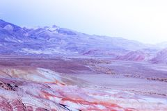 Colorful pink hills under the Sunny sky. Rocks and mountains of pastel colours royalty free stock image
