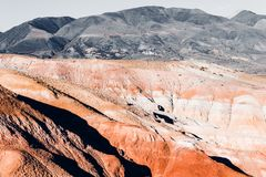 Colorful pink hills under the Sunny sky. Rocks and mountains of pastel colours royalty free stock images