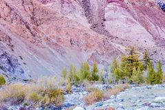 Colorful pink hills under the Sunny sky. Rocks and mountains of pastel colours stock images