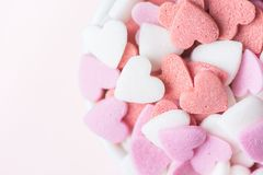 Colorful Pink Red White Sugar Sprinkles Candies in Bowl on White Background. Valentine Romantic Birthday Charity Mother`s Day Stock Images