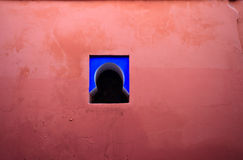 Colorful pink wall and blue window Stock Photo