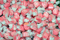 Colorful pink and white salt water taffy. Lots of colorful pink and white salt water taffy candies Stock Image