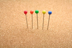 Colorful pins Stock Images