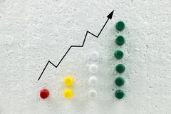 Colorful pins on polystyrene business growth chart. stock image