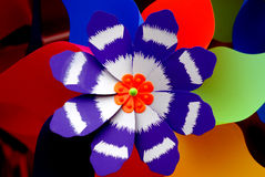 Colorful Pinwheel. Colorful plastic pinwheel, a mix of blue black,red ,green, white,orange and verdure Stock Images