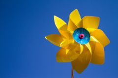Colorful pinwheel against blue gradient background stock image