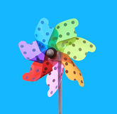 Colorful pinwheel on blue background Stock Photography