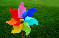 Colorful pinwheel on grass Stock Images