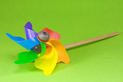Colorful pinwheel over green Stock Photos