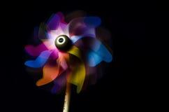 Colorful pinwheel. Pinwheel rotating on black background royalty free stock photo