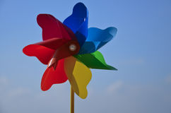 Colorful pinwheel toy. Against blue sky Royalty Free Stock Photos