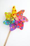 Colorful pinwheel toy on white background Royalty Free Stock Images
