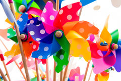 Colorful pinwheels against white background. Close-up of colorful pinwheels against white background Royalty Free Stock Images