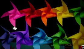 Colorful pinwheels on black background.  Royalty Free Stock Photo