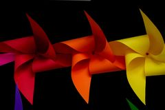 Colorful pinwheels on black background.  Royalty Free Stock Photos