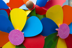 Colorful pinwheels. Multiple colored pinwheels against a natural background Royalty Free Stock Images