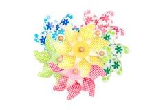 Colorful pinwheels on white Royalty Free Stock Photos