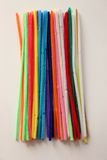 Colorful pipe cleaners. Multi colored pipe cleaners on white background royalty free stock images