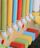 Colorful Pipes and Buckets. An assembly of old colored pipes and buckets at a Folk Art Festival Stock Photo