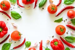 Colorful pizza ingredients pattern made of tomatoes, pepper, chili, garlic and basil on white background stock photos