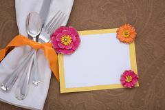 Colorful Place Setting with silverware, napkin and menu card on brown table Cloth with room or space for copy, text, or words, Hor. Izontal flat lay in orange Stock Photography