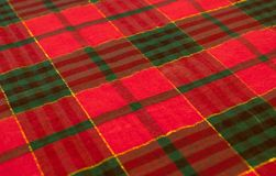 A colorful plaid table cloth backfround. Stock Image