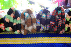 The colorful plaids on a market. Stock Images