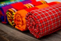 Colorful plaids of the Masai tribe. African blankets from Kenya and Tanzania. Blankets for the house. Shawls royalty free stock photos