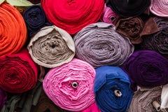 Colorful Plain Cotton Fabric Rolls on a Fabric Shop Shelf Stock Photography