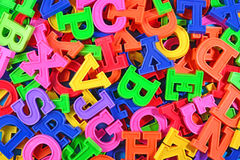 Colorful plastic alphabet letters as background Stock Images