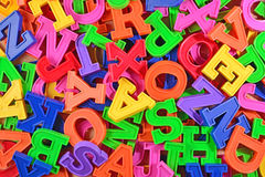Colorful plastic alphabet letters as background Stock Photography
