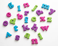 Colorful plastic alphabet letters on a white background Royalty Free Stock Photo