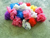 Colorful plastic bag. On cement floor Royalty Free Stock Photos