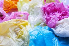 Colorful plastic bags waste. Background royalty free stock images